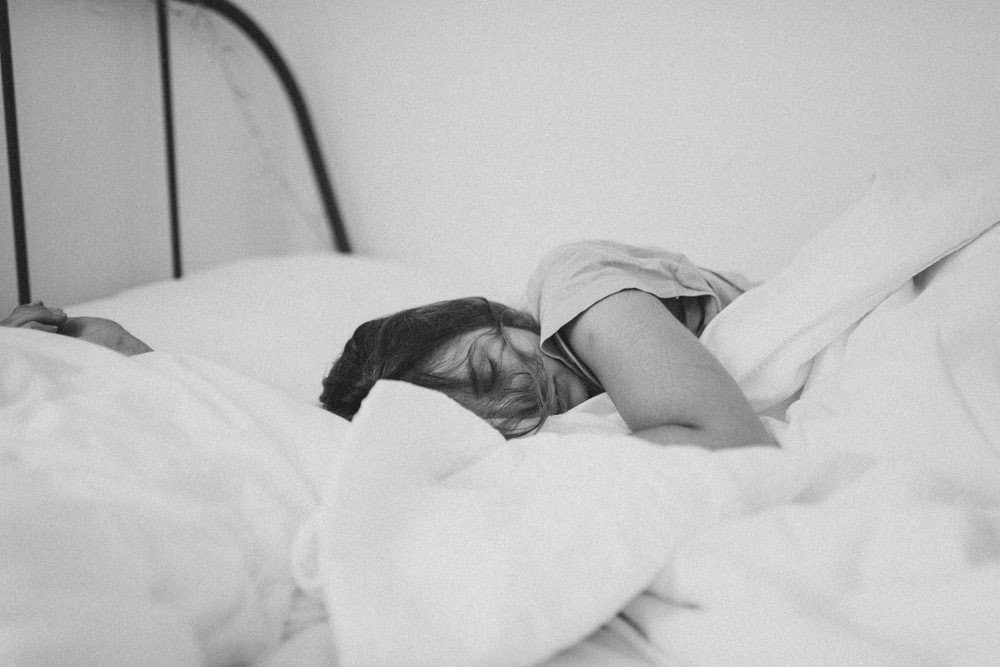 person sleeps soundly after hypnotherapy