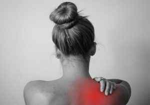 a woman suffering from chronic back pain
