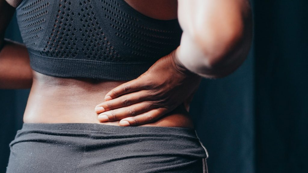 Woman with chronic back pain looking for a massage service in Preston