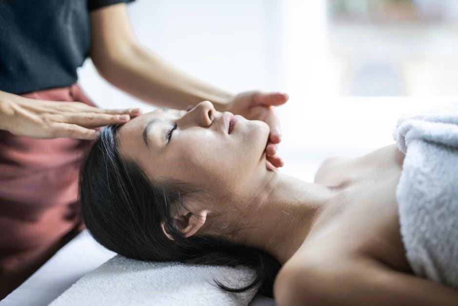 Woman getting head massage service in Preston